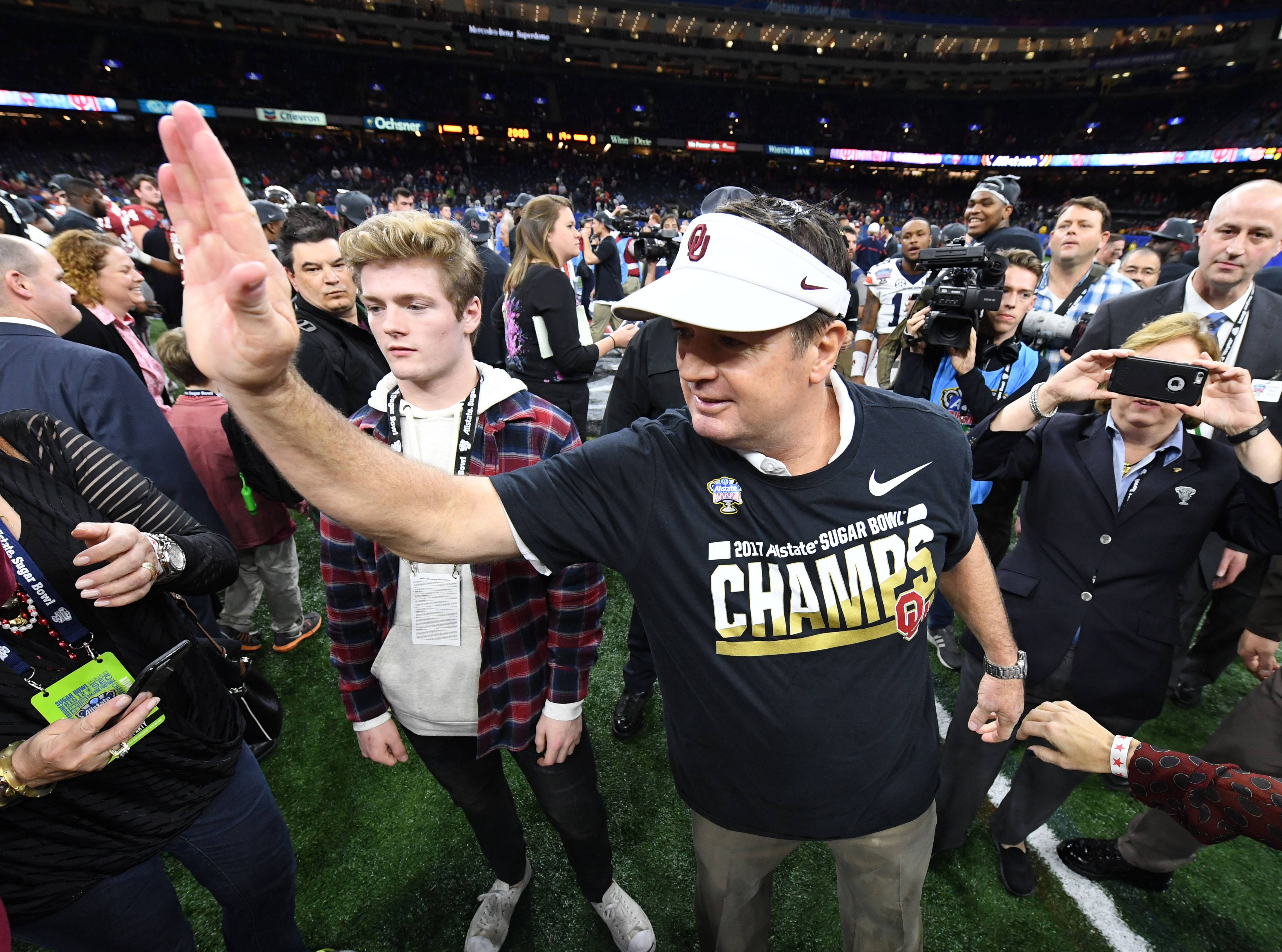 Bob stoops coaching resume controversial topic for research papers