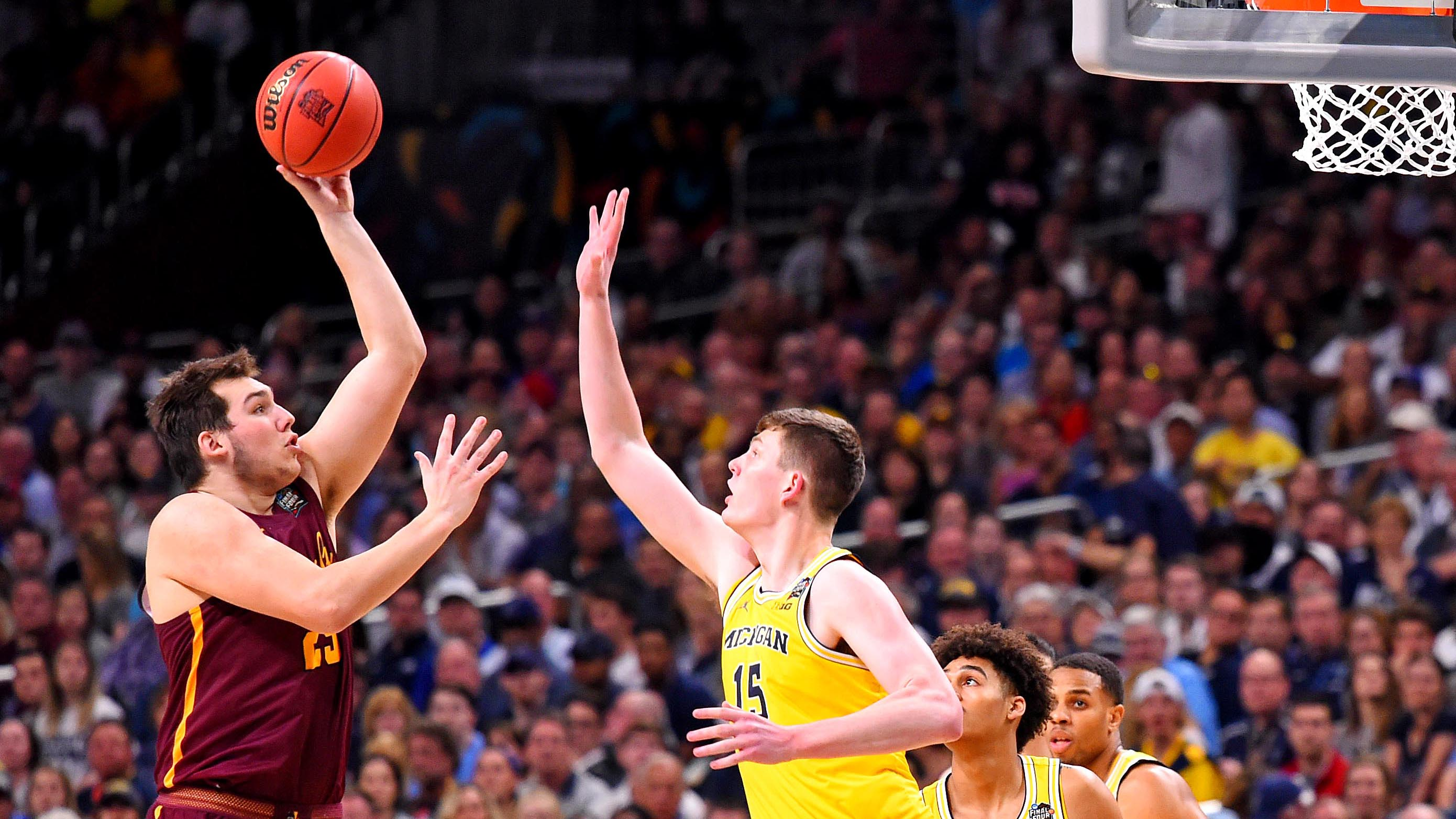 Loyola Chicago's Cameron Krutwig shoots over Michigan's Moritz Wagner