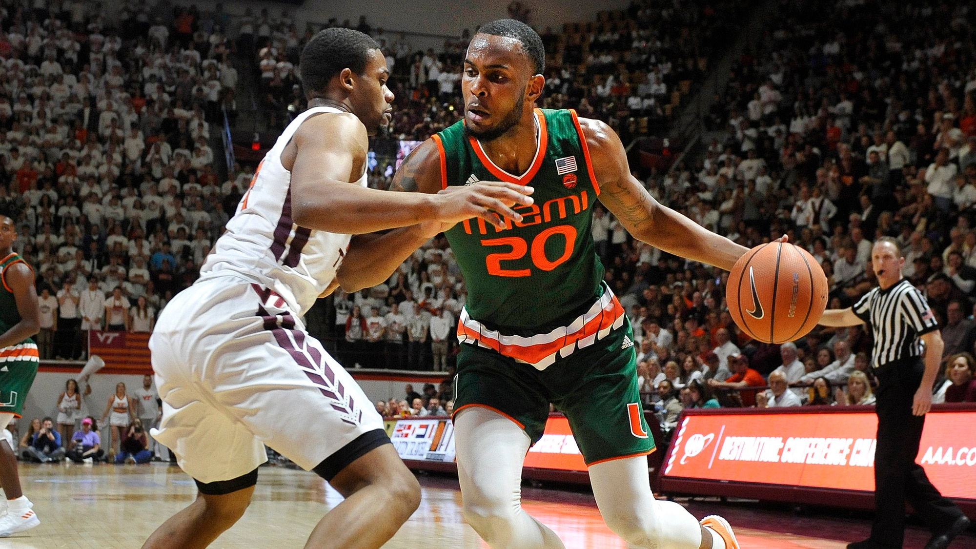 Miami's Dewan Huell drives to the basket