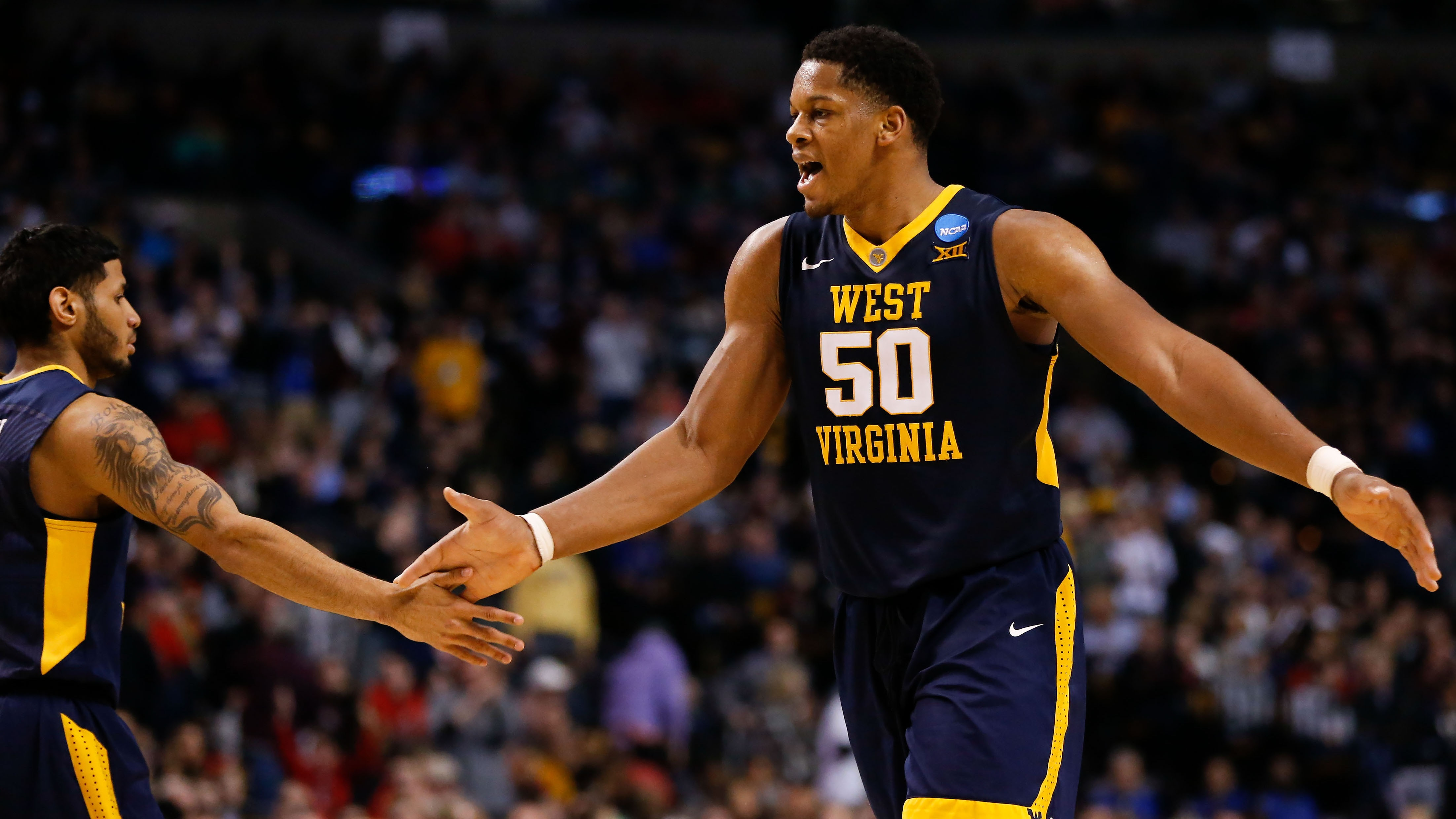 West Virginia's Sagaba Konate high fives a teammate