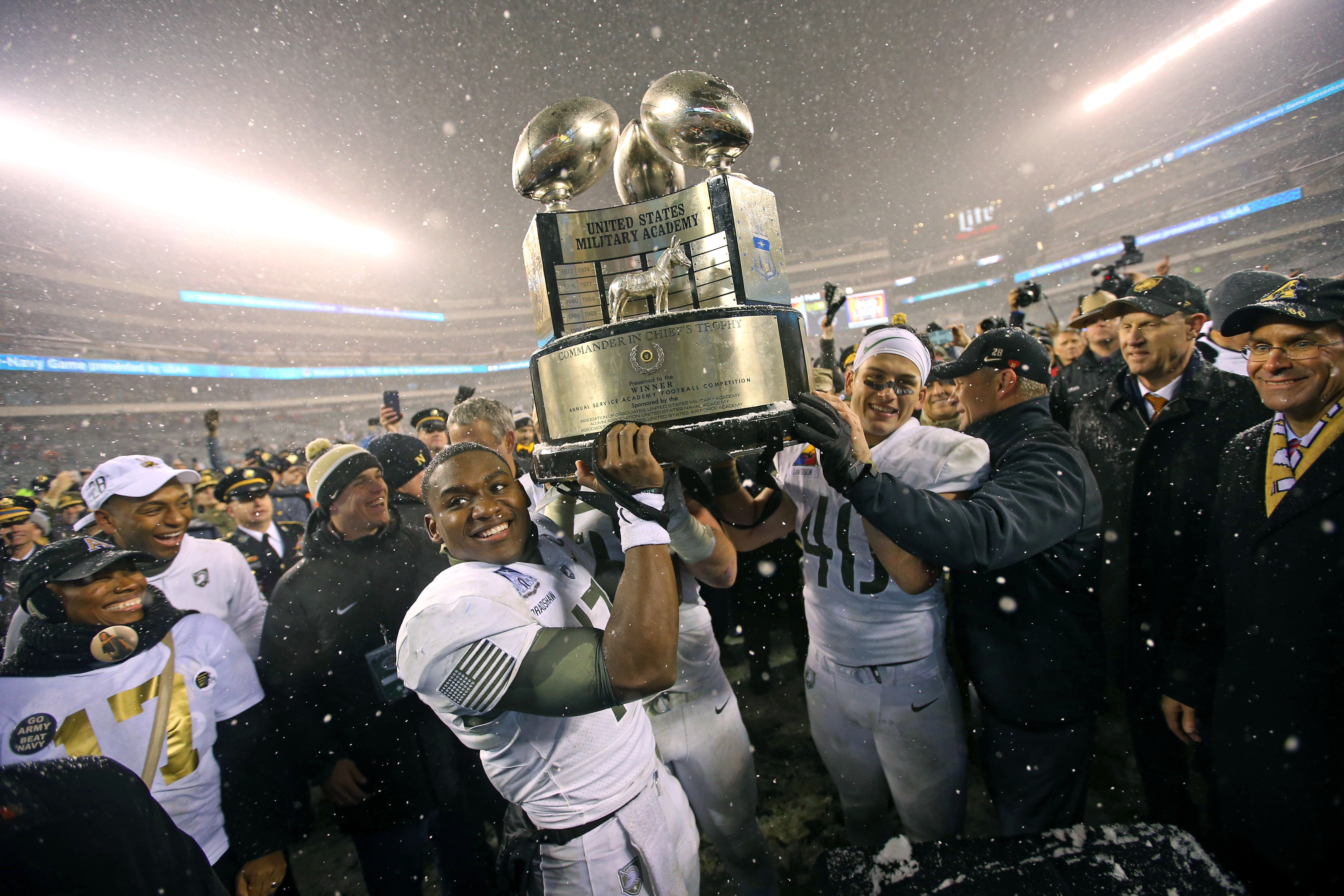 Army celebrating with the Commander-in-Chief's trophy last season.