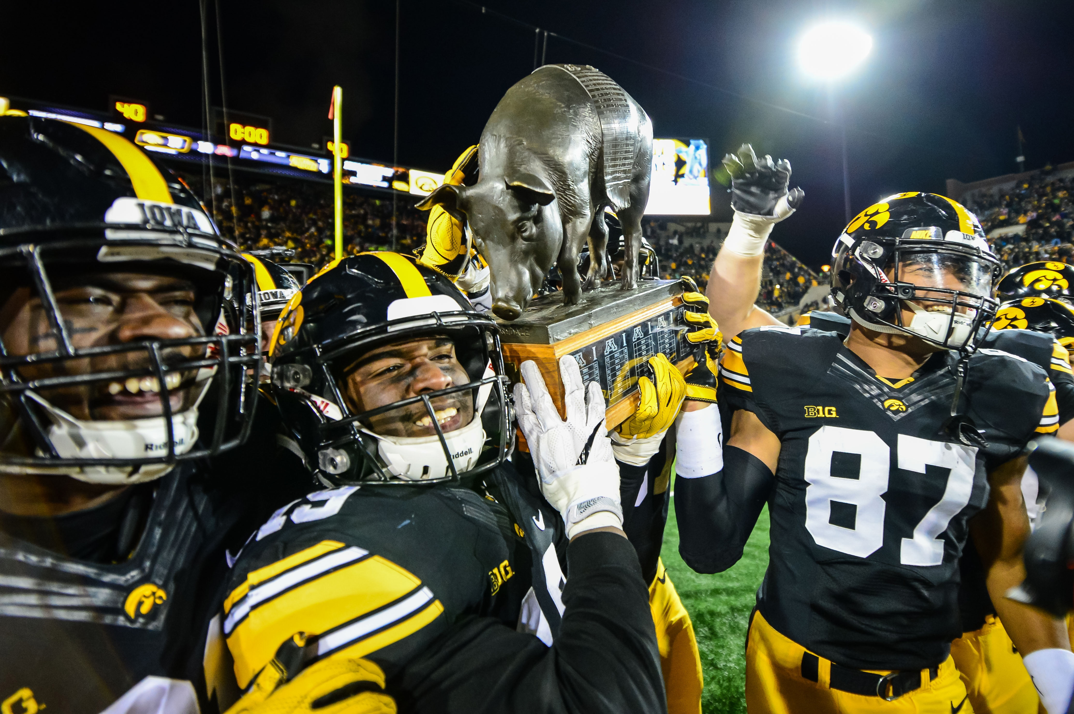 Iowa players with the Floyd of Rosedale trophy in 2017.