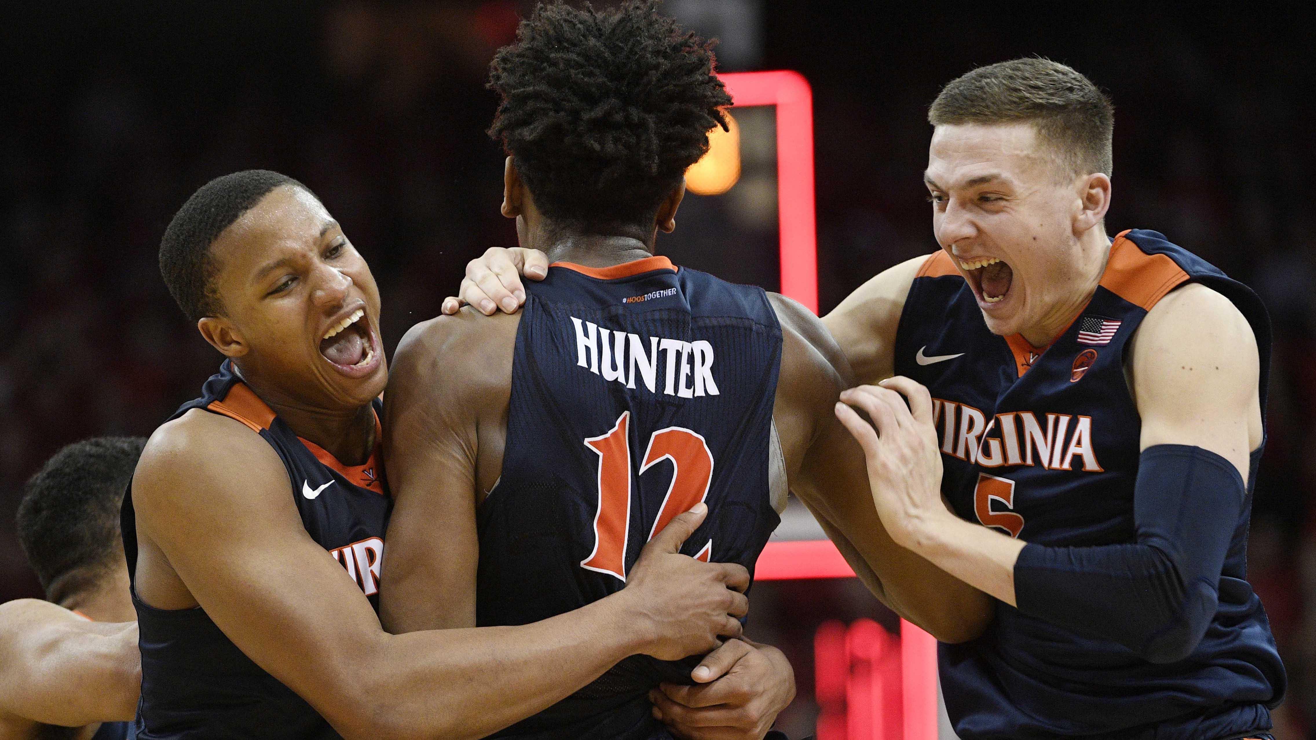 Virginia's De'Andre Hunter celebrates with teammates