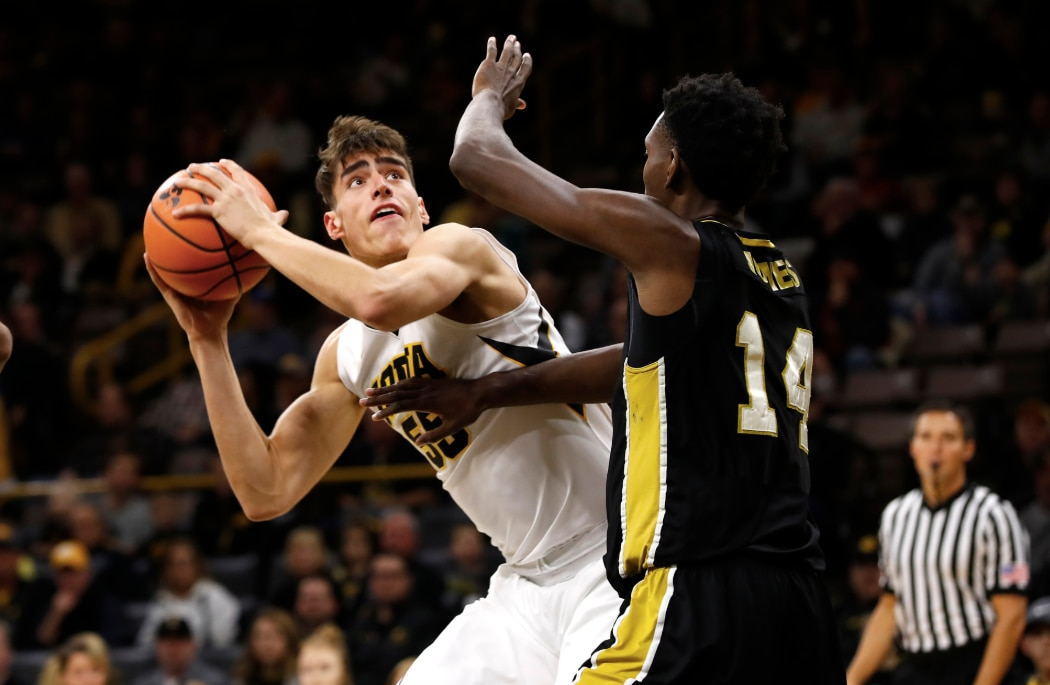 Iowa center Luke Garza hopes to make a full return to play for the Hawkeyes this season.