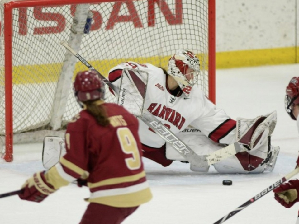 Harvard goaltender Lindsay Reed saves a shot during her team's win over Boston College.