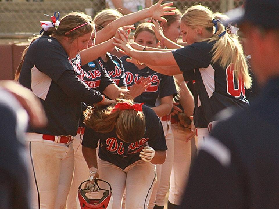 Dixie State's Nicole Chavez is congratulated after hitting a home run.
