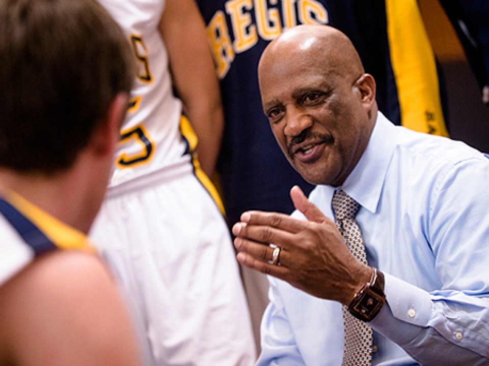 Lonnie Porter has coached Regis to seven 20-or-more win seasons.