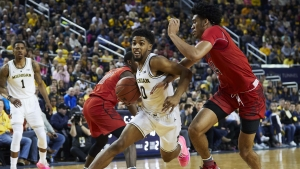 No. 6 Michigan beats No. 24 Maryland, 65-52