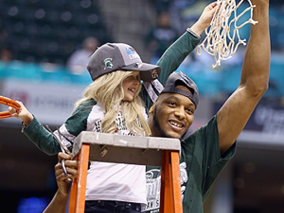 Adreian Payne celebrates Michigan State's Big Ten tournament championship with Lacey Holsworth.
