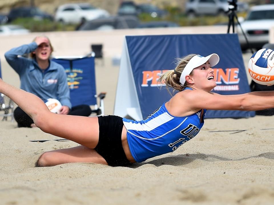 Nicole Mcnamara Of Ucla Digs The Ball While Playing Against Usc At Zuma Beach In Malibu California Back March