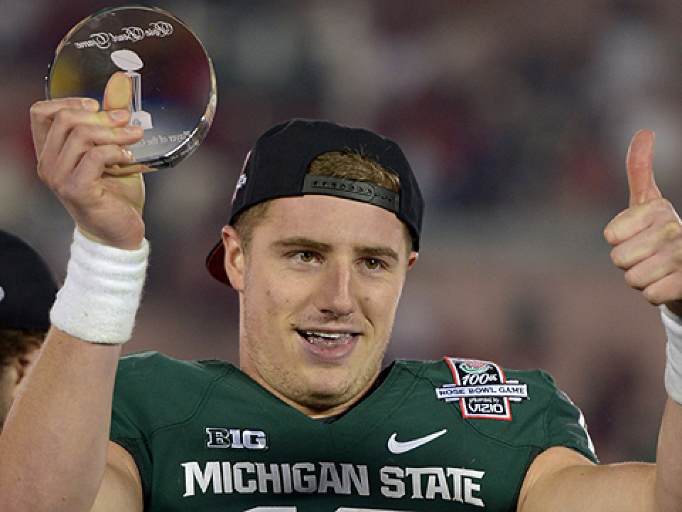 Michigan State QB Connor Cook gives a thumbs up to the new playoff system.