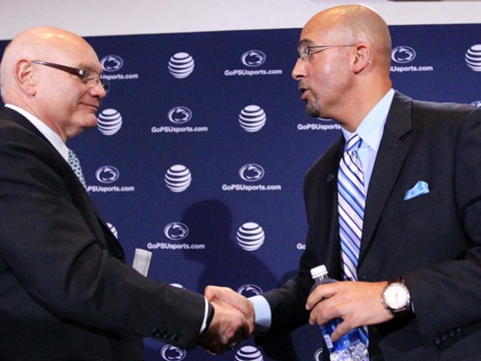 David Joyner (left) shakes hands with new head football coach James Franklin.