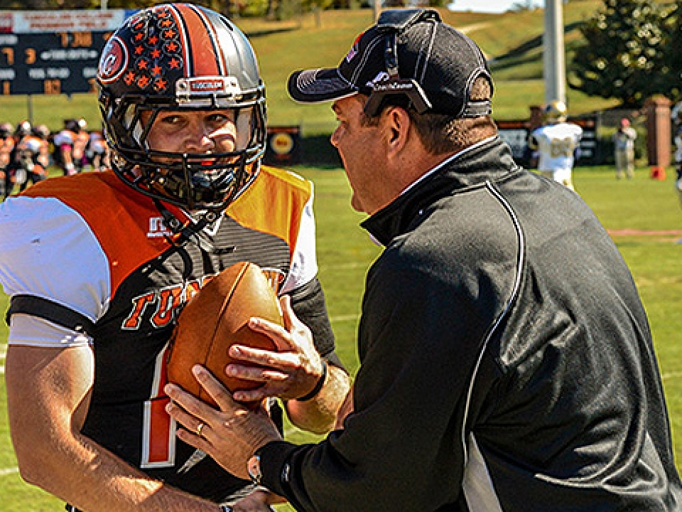 Bo Cordell is congratulated by head coach Frankie DeBusk after breaking the NCAA II passing record.