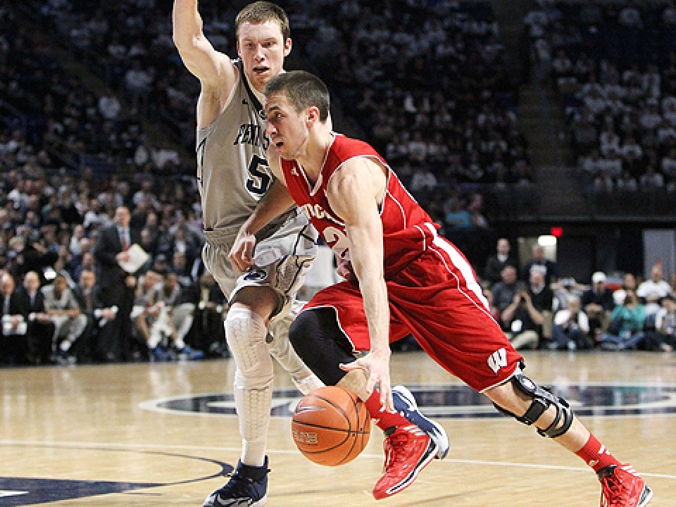 Wisconsin's Josh Gasser is guarded by Penn State's Donovon Jack.