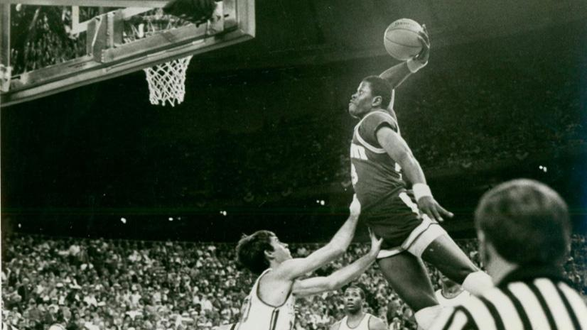 Georgetown's Patrick Ewing dunks over a Kentucky defender.