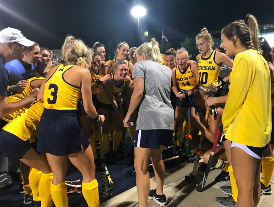 Michigan field hockey celebrates after topping Penn State 1-0.