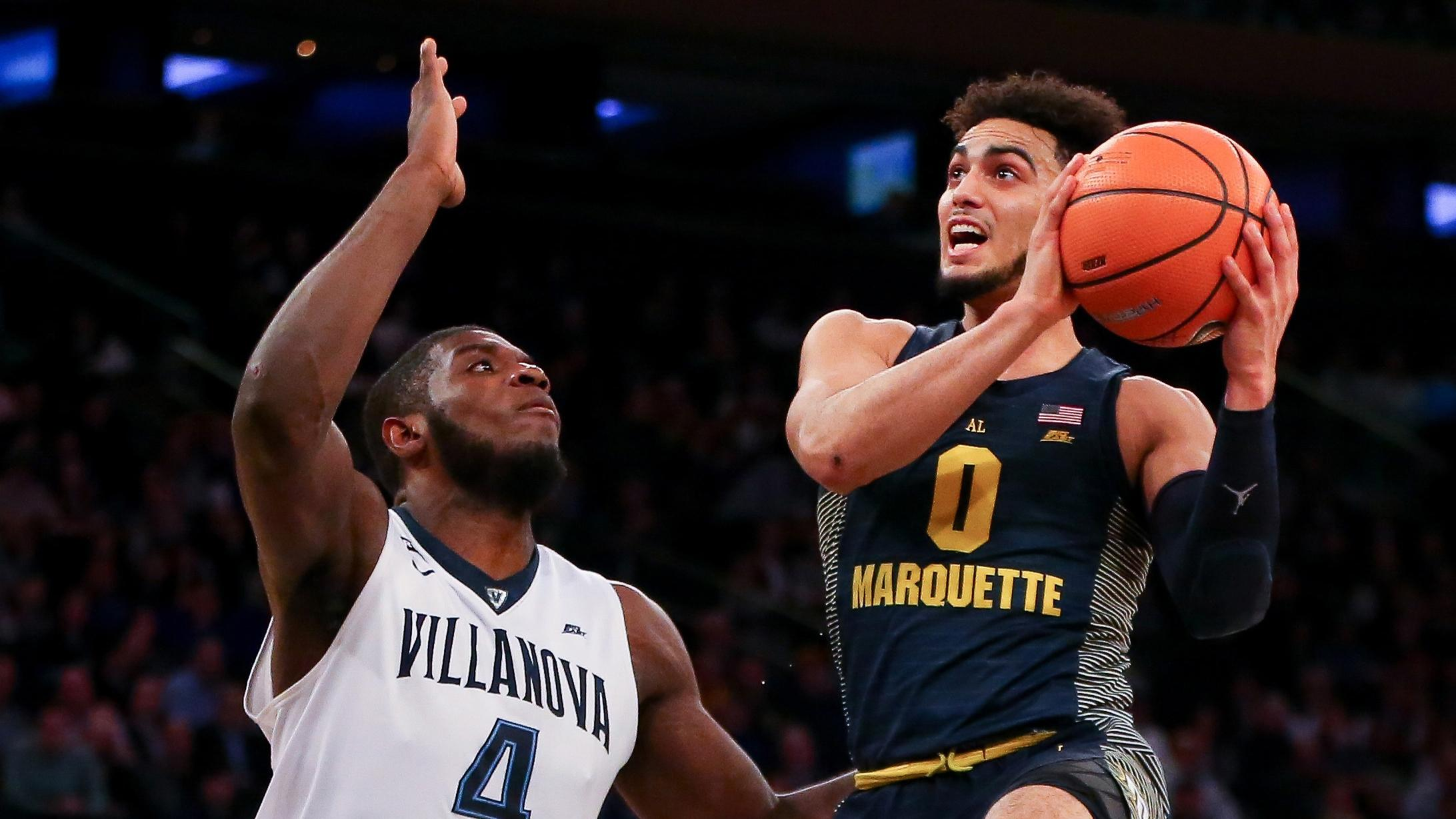 Marquette guard Markus Howard drives to the rim