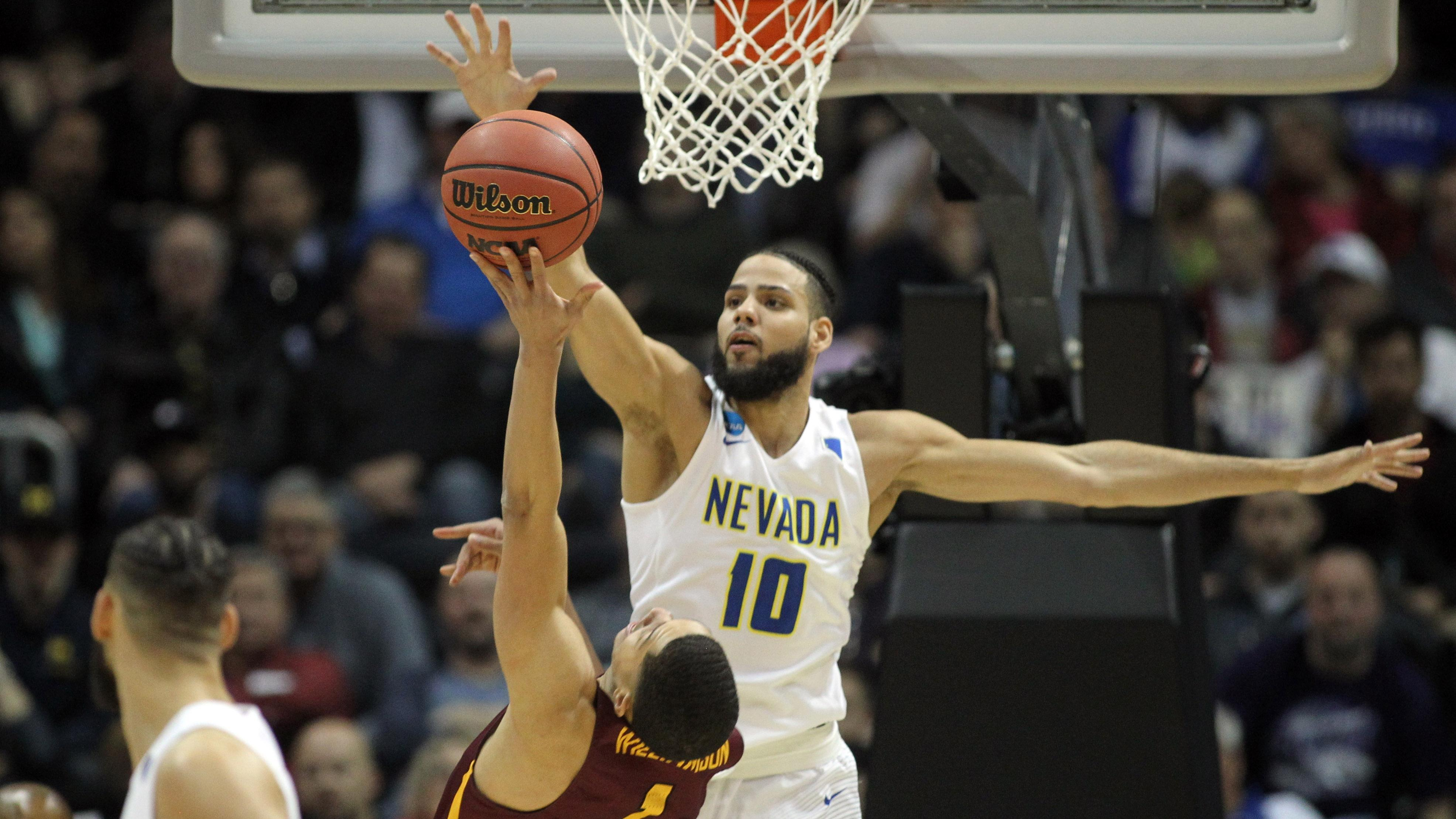 Nevada's Caleb Martin blocks a shot