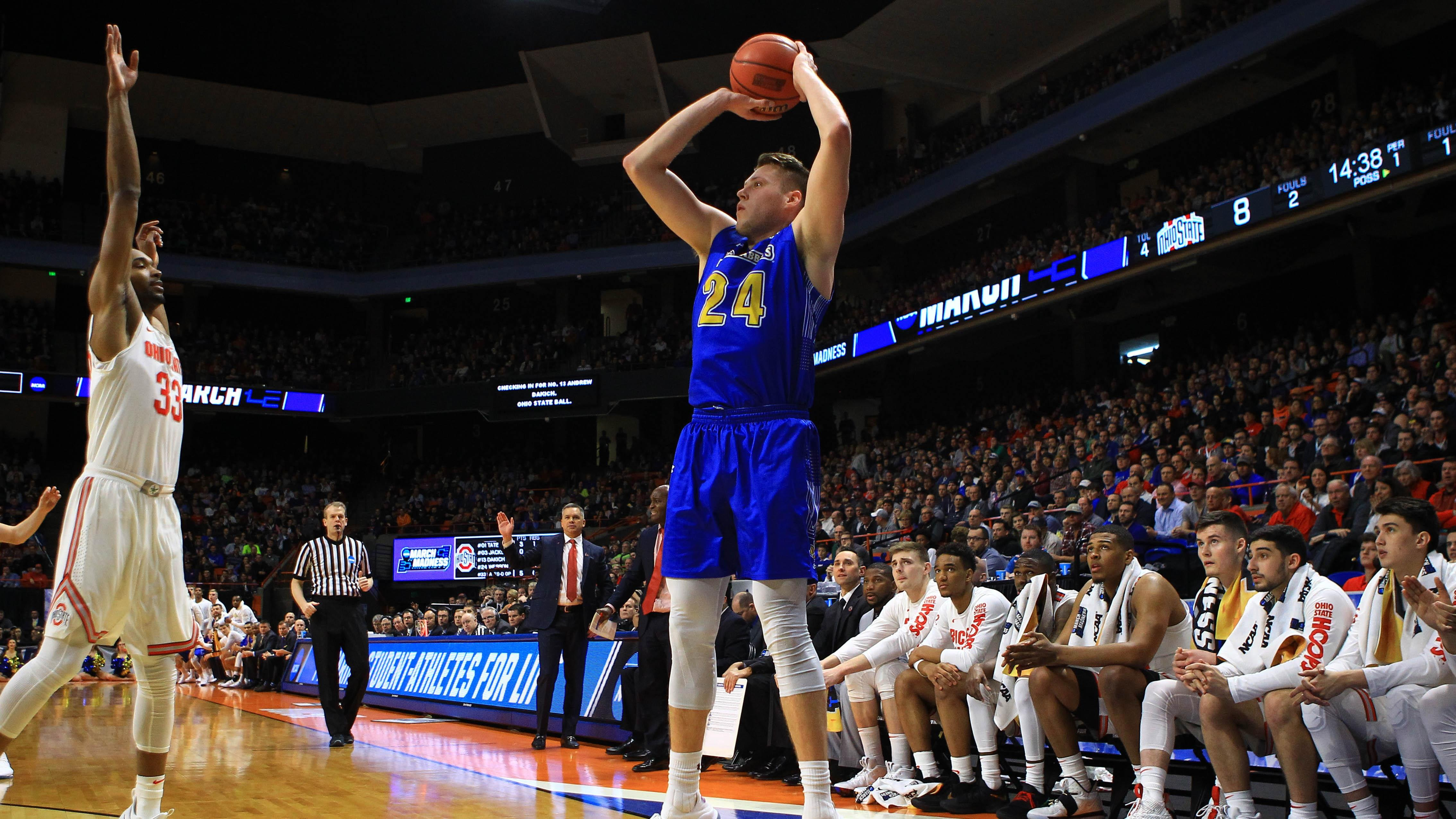 South Dakota State's Mike Daum takes a three