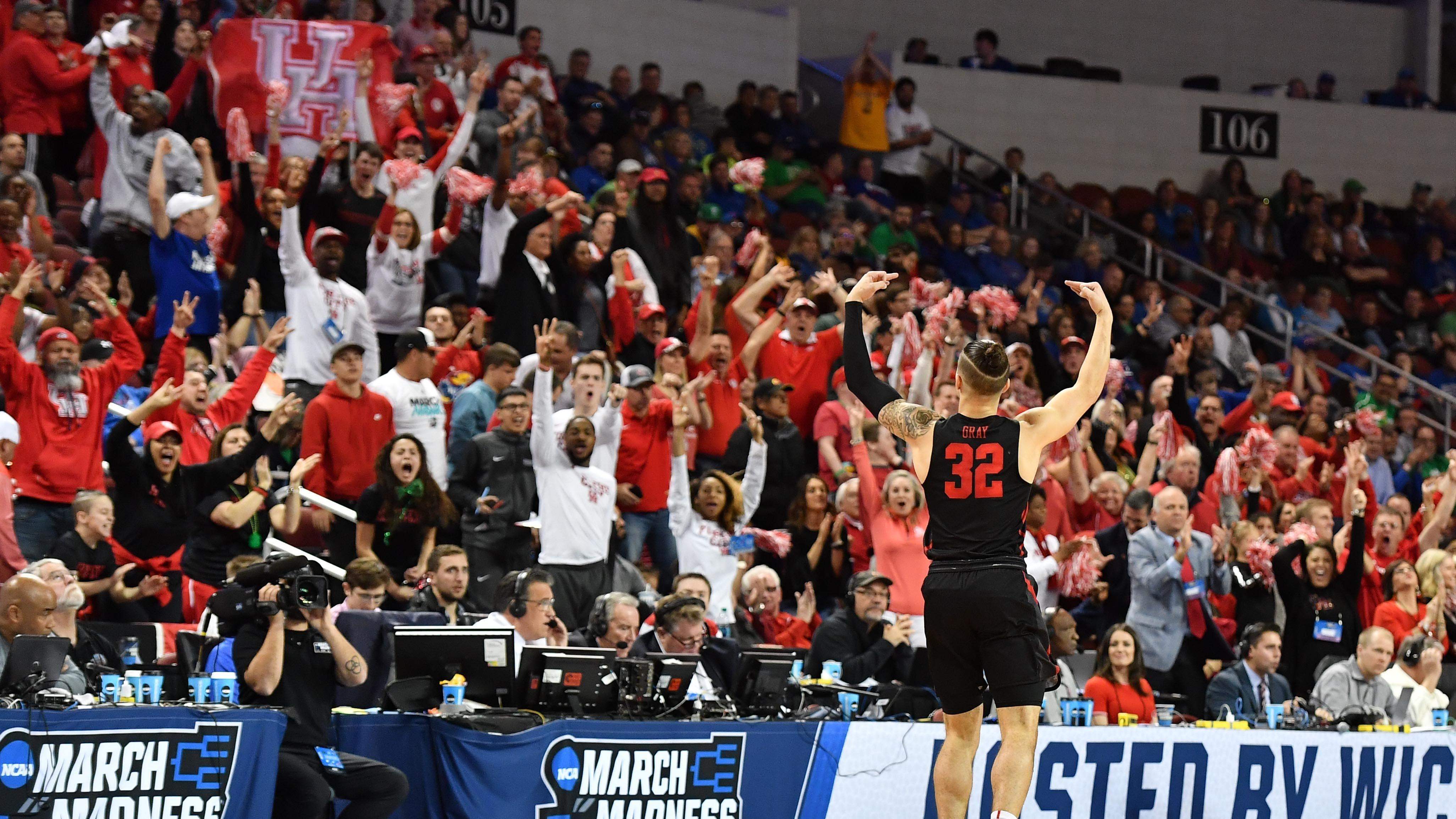 Former Houston guard Rob Gray celebrates with Cougars fans