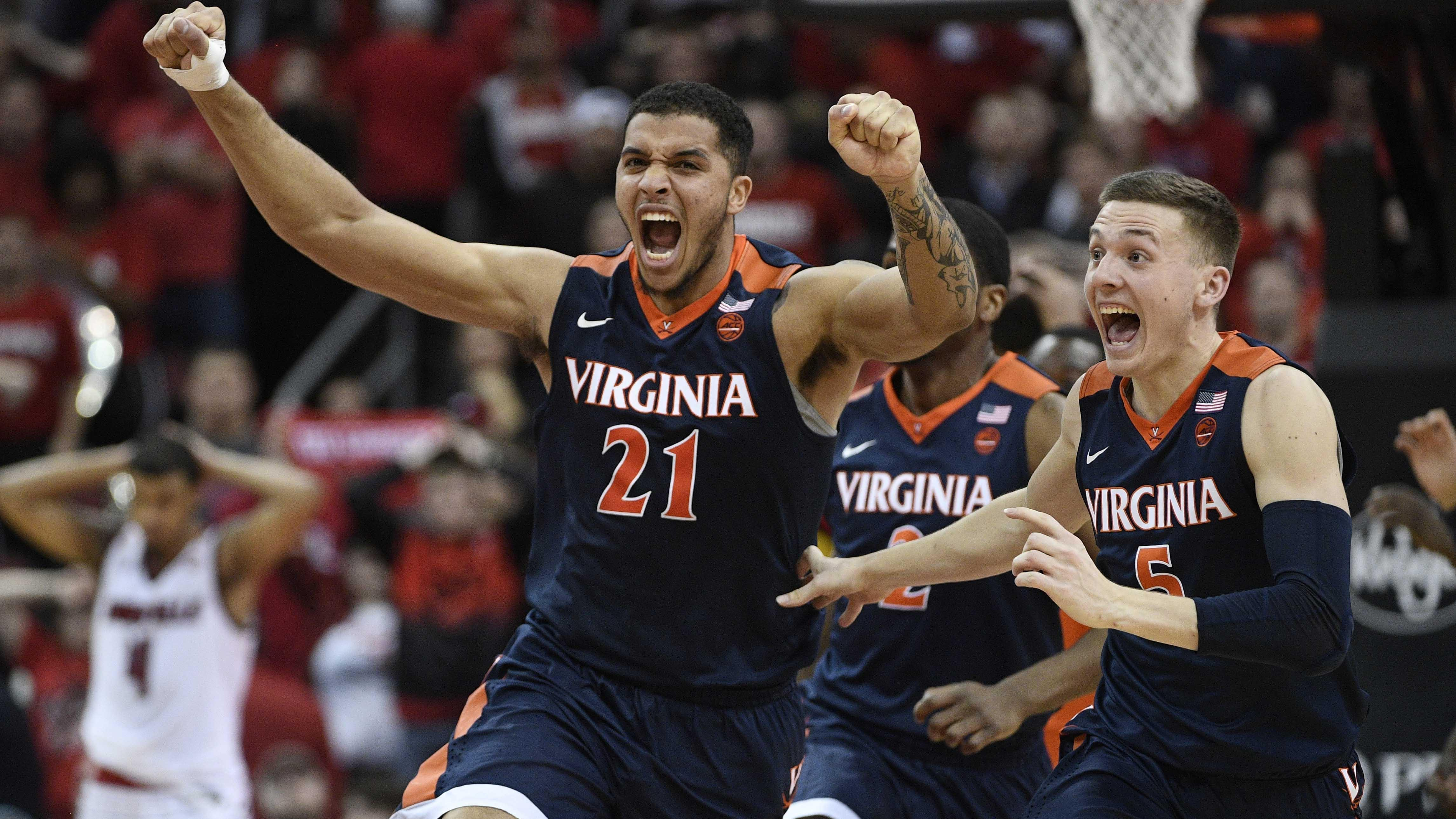 Virginia players celebrate after beating Louisville