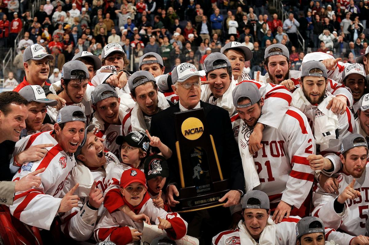 Boston University head coach Jack Parker celebrates with his team in 2009.