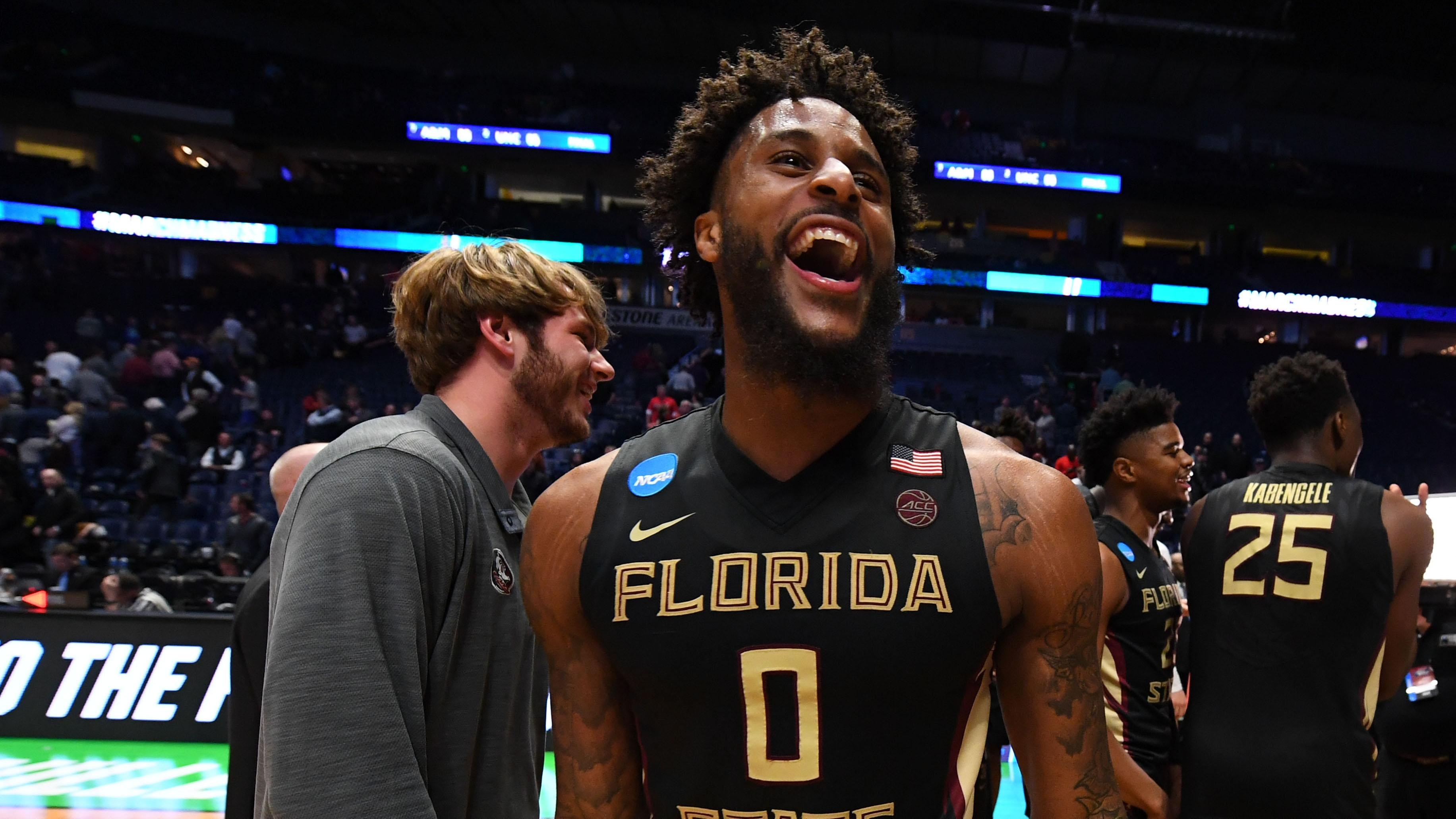 Florida State's Phil Cofer celebrates after beating Xavier