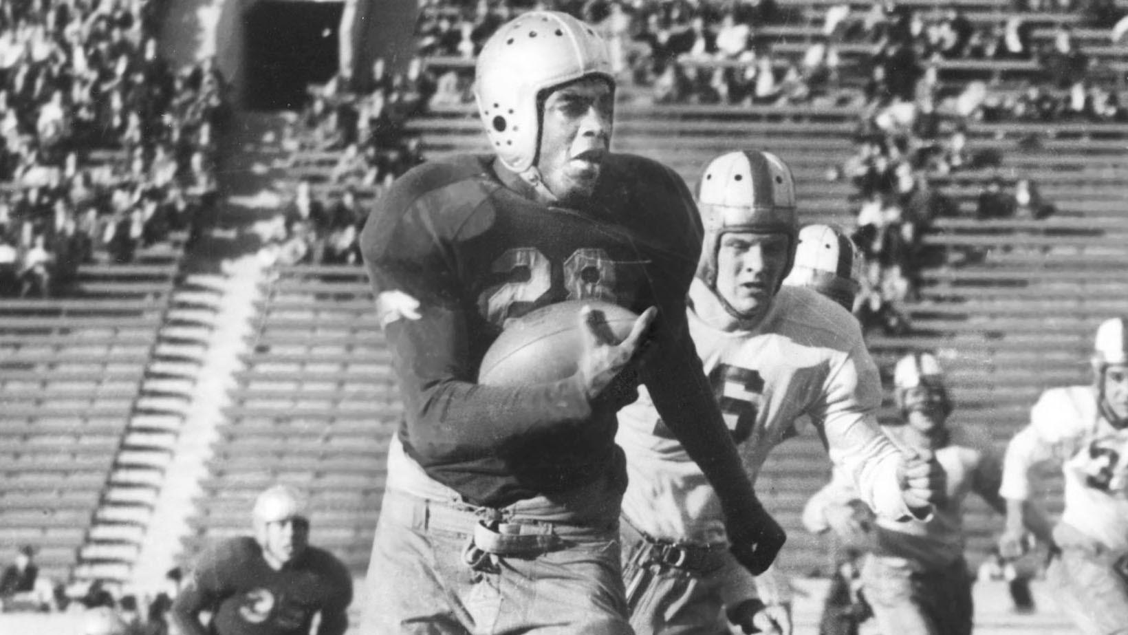 Jackie Robinson wore No. 28 for UCLA's football team. In this file photo, he's playing for the Bruins against Stanford.