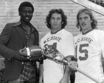 NC State's Stan Cockerton (right) stands next to Wolfpack running back Willie Burden (left) with fellow lacrosse teammate Bob Flintoff (center).