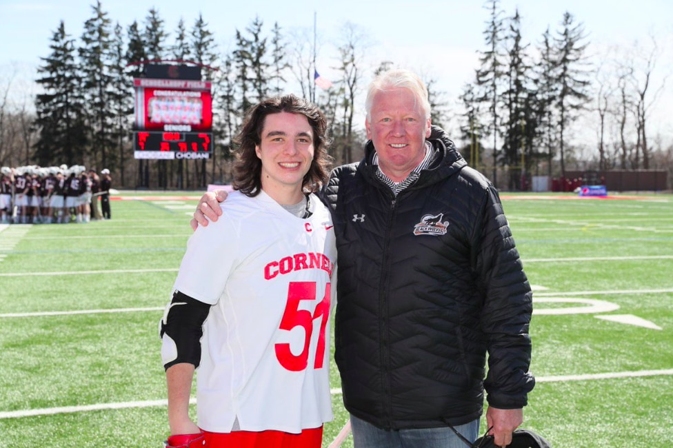 French (right) poses next to current Cornell lacrosse player Jeff Teat (left).
