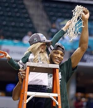 Adreian Payne celebrates Michigan State's Big Ten tournament title with Lacey Holsworth.