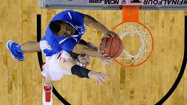 Kentucky's Marcus Lee dunks over Wisconsin's Frank Kaminsky.