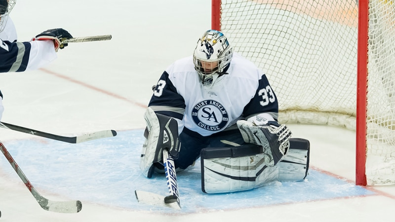 St. Anselm goaltender Maddie Scavotto makes a stop in a game against Holy Cross last season.