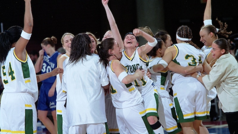 Cal Poly Pomona celebrates after winning its fifth DII women's basketball national championship.