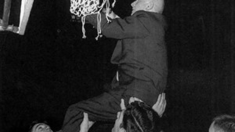 Everett Case cuts down the net with NC State