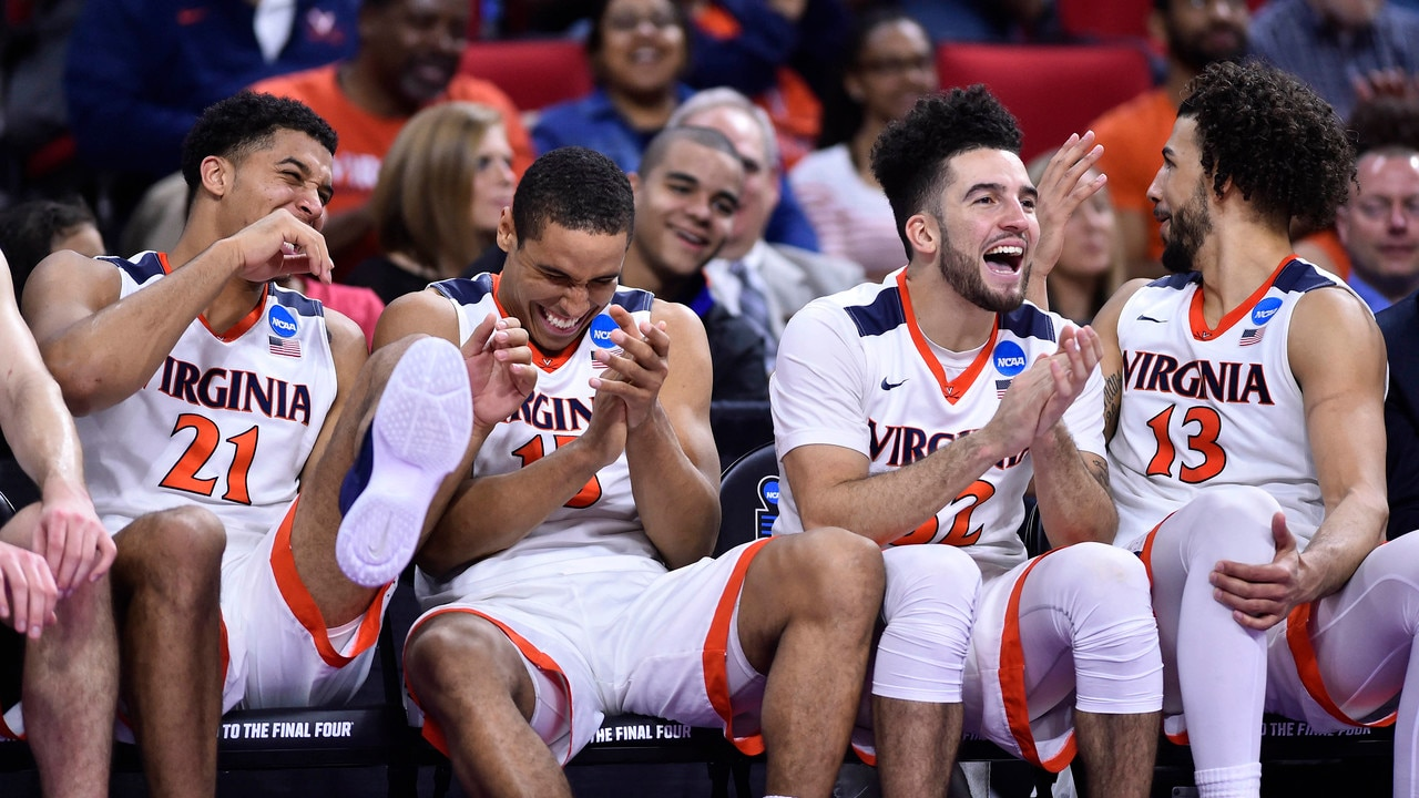 Virginia holds off a late Butler rally to win the Midwest Region 2nd Round  contest 77-69